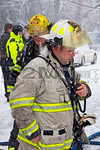 A firefighter on the scene of a Offaly Street working fire in North Amityville on February 3rd, 2014.