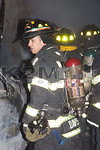 A firefighter on the scene of a working fire on Maple Place in West Hempstead [1-19-16].