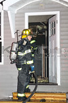 A firefighter on the scene of a double house fire on West Fulton Street in Long Beach [1-12-16].