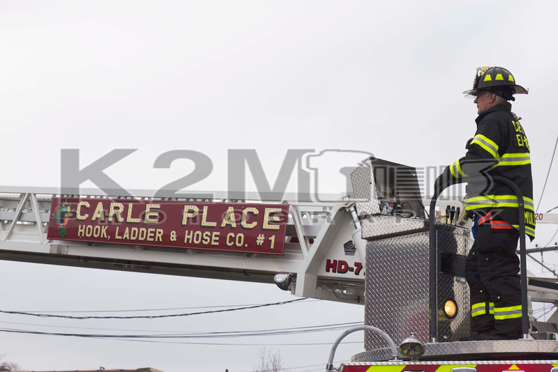 A firefighter on the scene of a building fire on Westbury Avenue in Carle Place [1-9-16].