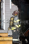 Oceanside Ex-Chief Bettes on the scene of a double house fire on West Fulton Street in Long Beach [1-12-16].