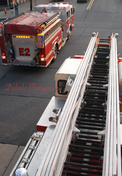 Mount Carmel Truck 2, right, and Engine 2 backing up into the station.
