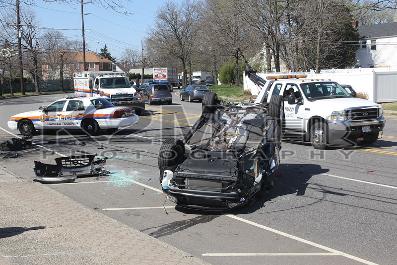 Friday, March 30th, 2012: The Garden City Park Fire Department responded to a report of an overturned auto in front of 1000 Marcus Avenue [the New Hyde Park Knights of Columbus building].  Upon arrival units found a one vehicle accident in which the driver [the only occupant of the car] had self-extricated.  The driver was transported to an area hospital.