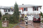 Monday, October 9th, 2017: the Roslyn Fire Companies operated on the scene of a working fire at 166 Old Powerhouse Road.  Firefighters battled fire on the second floor of a two-story private dwelling.  All occupants made it safely out of the home including a dog that was rescued.  The fire reached a second alarm status.