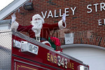 Sunday, December 14th, 2014: A member of Valley Stream Engine 3 prior to their annual Santa Run.