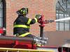 A Rockport firefighter manning the deck gun.