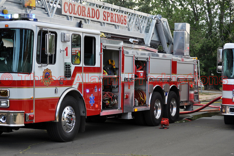 Colorado Springs Fire Department's Ladder Truck 1 on the scene of a fire, inside a home on Chalmers Road, in Colorado Springs, Colorado. Fire crews did a quick attack from the interior of the home, to get this fire controlled in a short amount of time.