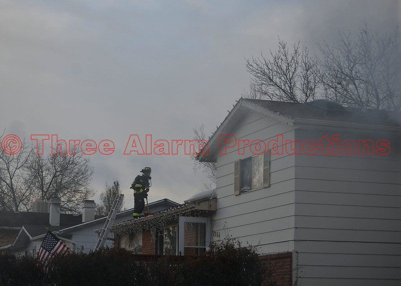 Cimarron Hills Firefighters work to bring a house fire under control on Sioux Circle South in El Paso County, Colorado. CHFD Engine 1311 was the first company to arrive on scene with light smoke showing from the roof of the home. Date of Incident: 12/14/2014<br /> Units on scene: Cimarron Hills Fire Department's Chief 1304, Engine 1311, Squad 1371, and Ambulance 1381. Peterson Air Force Base Fire Department's Engine 21.  Falcon Fire Department's Engine 313. Colorado Springs Fire Department's Engine 17.