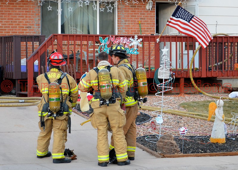 Peterson Air Force Base Firefighters assisting Cimarron Hills Firefighters on an attic fire on Sioux Circle South in El Paso County, Colorado.