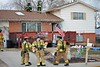 Interior fire crew goes into the attic space to bring the fire under control on Sioux Circle.