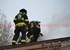 Roof crew performing vertical ventilation to bring an attic fire under control in El Paso County, Colorado, USA.