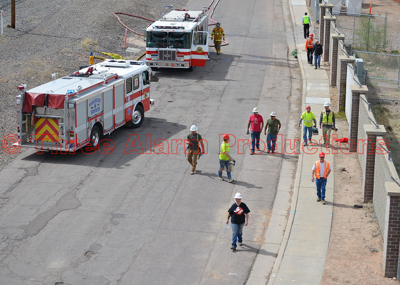 Colorado Springs Utilities Employees evacuating the premises of the Walter Drake Power Plant due to a massive fire. 5/5/2014