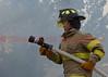 An Ellicott Firefighter advancing hose on a blaze involving multiple structures. June 16, 2014
