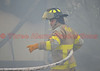 An Ellicott Firefighter advancing a hose line on a garage fire in El Paso County.