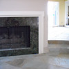 Single-piece APHRODITE granite fireplace surround<br /> Installed in League City $2500