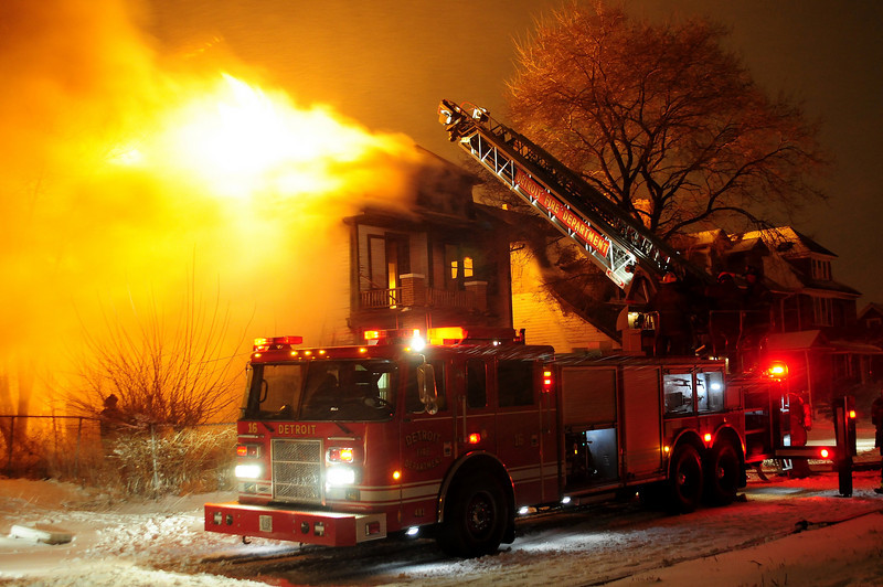 Box Alarm Georgia and Van Dyke 3.11.11 ladder 16   of  the  Detriot  waits  for water / note  3 inches of  snow and  strongs winds  hamper firefighter efforts