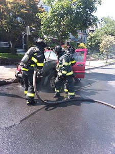 Probationary Firefighter Rottman's first car fire. Photo by Garry Clarke