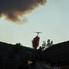 CDF S2T drops fire retardant on Elizabeth Lake Road at Lake Fire, Lake Hughes, CA. 08-12-2020