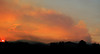 2011-07-03. Back home after a week of evacuation for the Las Conchas fire. Sunset over the Jemez. Spot fires in the canyons.