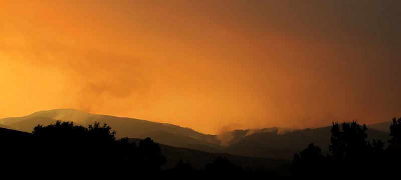 2011-07-03. Late afternoon, near sunset. Spot fires burning on Caballo, in the canyons.