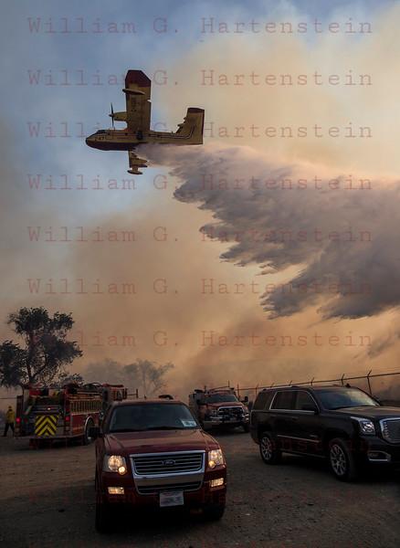 Rye Fire Super Scooper makes a drop over Valencia Travel Village 12-05-2017