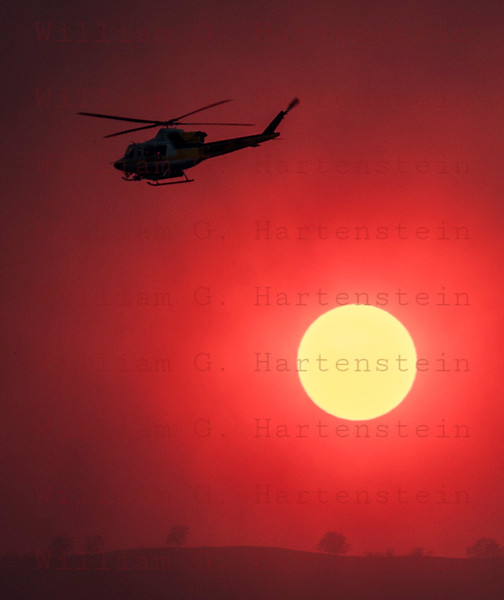 Rye Fire LACoFD Copter 11 passes just above the Sun 12-05-2017