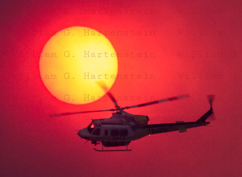 Rye Fire LACoFD Copter 17 passes just below the Sun 12-05-2017
