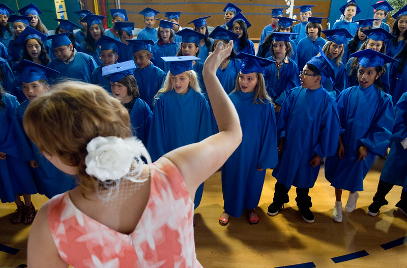 "Kim Alspaugh, a music teacher at University Hill Elementary, leads the students in song during the 5th grade continuation ceremony at University Hill Elementary on Thursday.<br /> More photos:  <a href=""http://www.dailycamera.com"">http://www.dailycamera.com</a><br /> (Autumn Parry/Staff Photographer)<br /> May 26, 2016"