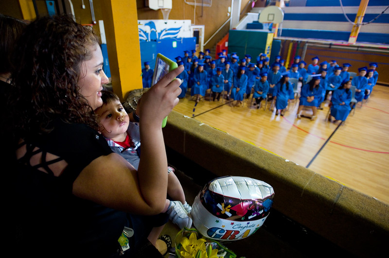 "Cecilia Lopez sits with Corey Garcia, 1, as she records video of her son, Alex Lopez, who is part of the 5th grade continuation ceremony at University Hill Elementary.<br /> More photos:  <a href=""http://www.dailycamera.com"">http://www.dailycamera.com</a><br /> (Autumn Parry/Staff Photographer)<br /> May 26, 2016"