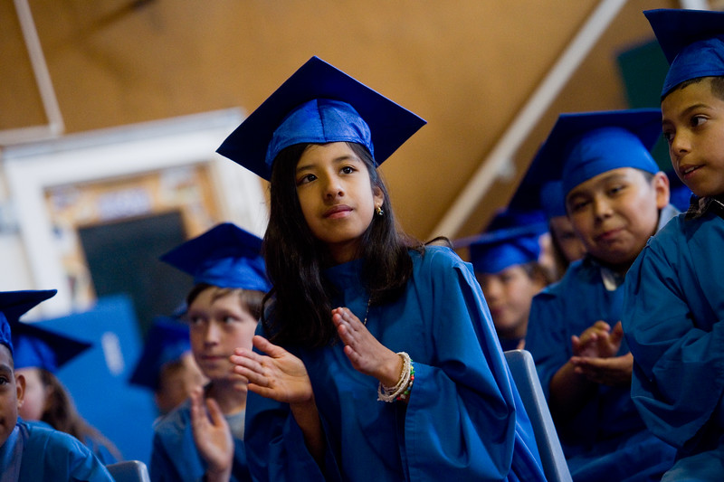 "Maria Fernanda Arias-Aguilar applauds for student speakers during the 5th grade continuation ceremony at University Hill Elementary on Thursday.<br /> More photos:  <a href=""http://www.dailycamera.com"">http://www.dailycamera.com</a><br /> (Autumn Parry/Staff Photographer)<br /> May 26, 2016"