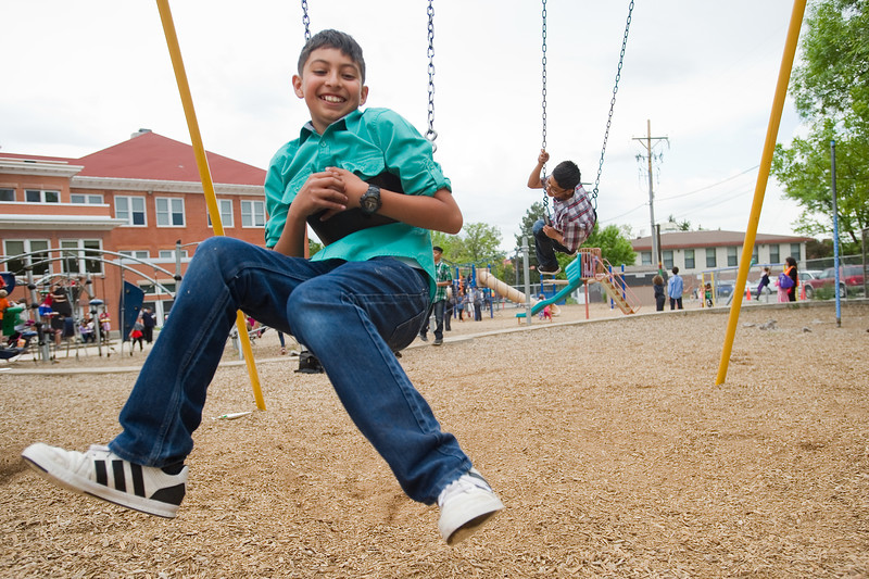 "Kevin Martinez swings backwards with Alex Lopez (right) after the 5th grade continuation ceremony at University Hill Elementary on Thursday.<br /> More photos:  <a href=""http://www.dailycamera.com"">http://www.dailycamera.com</a><br /> (Autumn Parry/Staff Photographer)<br /> May 26, 2016"