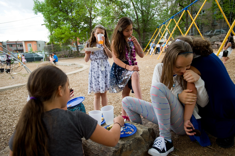 "Jaya Kohm and Paloma Espinosa (center) eat lunch while McKenzie Jones receives a hug from Isabella Goodwin (right) after the 5th grade continuation ceremony at University Hill Elementary on Thursday.<br /> More photos:  <a href=""http://www.dailycamera.com"">http://www.dailycamera.com</a><br /> (Autumn Parry/Staff Photographer)<br /> May 26, 2016"