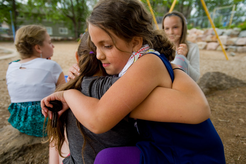 "Isabella Goodwin (right) hugs Selma Yavuz after the 5th grade continuation ceremony at University Hill Elementary on Thursday.<br /> More photos:  <a href=""http://www.dailycamera.com"">http://www.dailycamera.com</a><br /> (Autumn Parry/Staff Photographer)<br /> May 26, 2016"