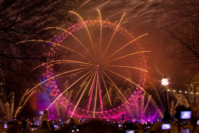 Fireworks are fired from the EDF Energy London Eye to mark the start of London's Olympic Year.  Thousands of revellers lined the streets of London to celebrate.London, UK. 1st January 2012.