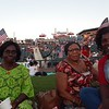 From right, Lowell residents Beatrice Stevens, Margaret Brobbey and Comfort Hadgyes, get ready for Fourth of July fireworks at LeLacheur Park. Sun/Aaron Curtis