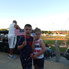 Frankie Rivera, 6, and Stella Rivera, 3, of Dracut, show their patriotism before the fireworks explode over LeLacheur Park on the Fourth of July. Sun/Aaron Curtis