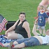 Ariana,  2-year-old Wyatt and Josh Chapman, of Billerica, wait for the Fourth of July fireworks show at LeLacheur Park. Sun/Aaron Curtis