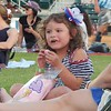Briana Correa, 5, of Lowell, enjoys some cotton candy before the Fourth of July fireworks start at LeLacheur Park. Sun/Aaron Curtis