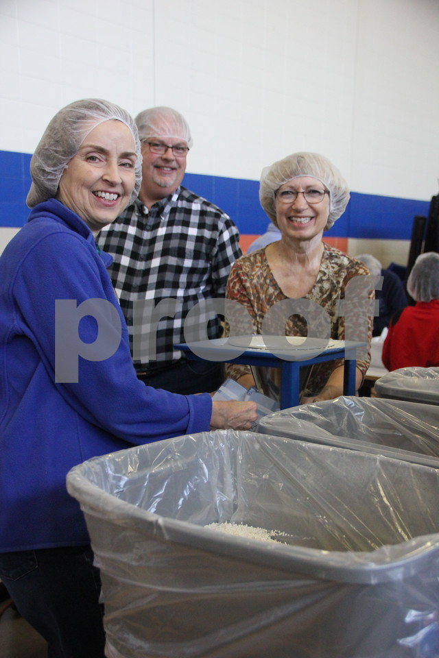 Pictured (left to right) is: Jeanette Tedeschi, Terry Pavel, and Charlene Anderson bagging rice to be sealed and packed into boxes. Saturday, December 5, 2015, Fort Dodge Christian Community School put on their 1st Annual Packing Meals for Starving Children event. The school Gymnasium was the staging area for packing the meals into boxes.