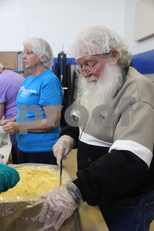 Saturday, December 5, 2015, Fort Dodge Christian Community School put on their 1st Annual Packing Meals for Starving Children event. At the time these pictures were being taken, there were 178 volunteers on hand not including those volunteering in others areas not involving packing the meals. Pictured here is : Gary Edgerton.