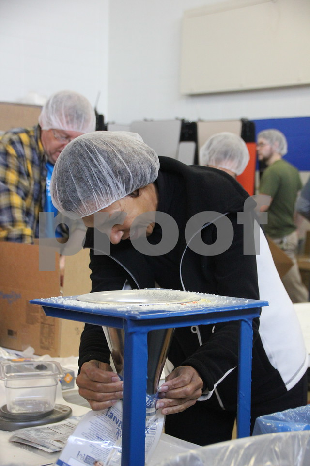 Clarice Thompson fills bags of rice to be sealed and packed into boxes. Saturday, December 5, 2015, Fort Dodge Christian Community School put on their 1st Annual Packing Meals for Starving Children event. The event was staged in the school gymnasium.