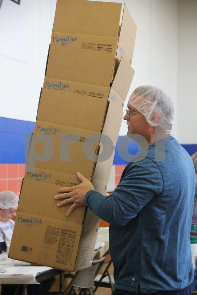 Pictured is Lonny Brandel , restocking empty boxes to be packed with food. Saturday, December 5, 2015, Fort Dodge Christian Community School put on their 1st Annual Packing Meals for Starving Children event. At the time these pictures were being taken, there were 178 volunteers on hand not including those volunteering in others areas not involving packing the meals. The staging area for packing the meals into boxes was the school gymnasium.
