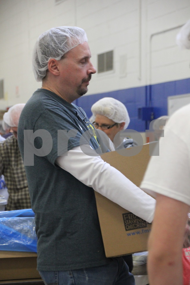 Saturday, December 5, 2015, Fort Dodge Christian Community School put on their 1st Annual Packing Meals for Starving Children event. Seen here, delivering a box to the next stage in the process is Scott Hatton. The event was staged in the school gymnasium.