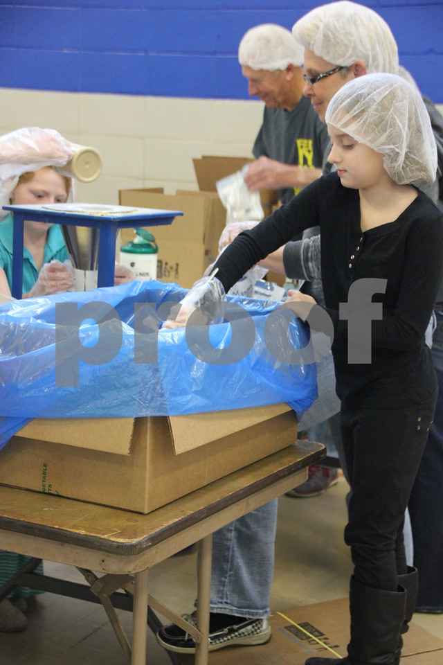 Saturday, December 5, 2015, Fort Dodge Christian Community School put on their 1st Annual Packing Meals for Starving Children event. At the time these pictures were being taken, there were 178 volunteers on hand not including those volunteering in others areas not involving packing the meals.There was a wide range of ages present who volunteered their time and energy to  the event.  Seen here is:Tessa Lyon.  Packing the meals into boxes took place in the school gymnasium which was designated as the staging area.