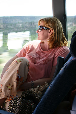 Melaney Fischer, Captain of the Red Bus, maintains style and comfort with her designer sunglasses and novelty pajamas.