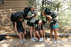 Shelby, Morgan, Jordan, and Kaycee strain under the heavy load of an EMPTY pack during preparations for their overnight backpacking trip.