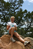 Jennifer takes a break at the top of Glorieta Lookout Peak during the Hiking Track.