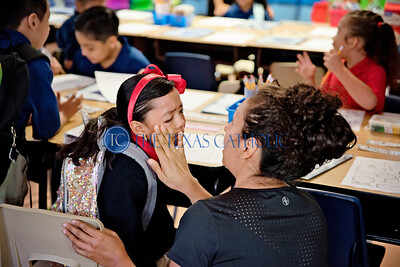 Gloria Felix wipes away tears as she says goodbye to her daughter, Paula Felix, on the first day of school Aug. 8 at Santa Clara of Assisi Catholic Academy.