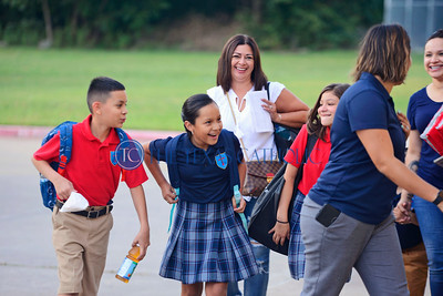 Students arrive in light spirits on the first day of school Aug. 8 at Santa Clara of Assisi Catholic School.