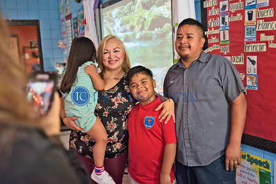 Xavier Vidal and his family take a picture Aug. 8 on the first day of school at Santa Clara of Assisi Catholic School.